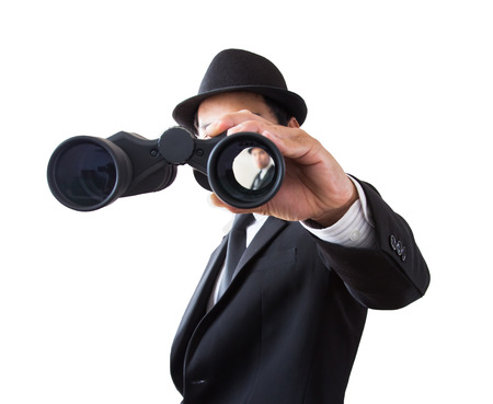 Businessman using binoculars on a white background.