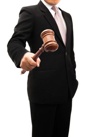 Businessman holder wooden justice in the hands.