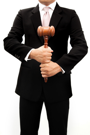 ruling: Businessman holder wooden justice in the hands.
