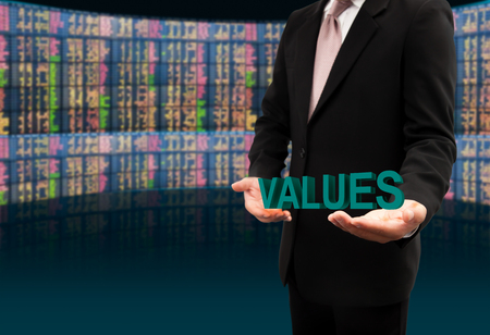 Values text on hands businessman.