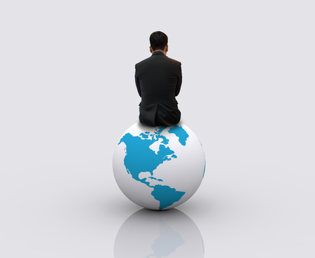 Businessman sitting on the globe