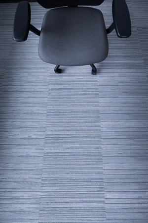Office chair on the grey carpet. Reklamní fotografie