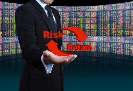 Risk and return symbol on hands.