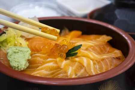 Salmon don with salmon eggs in restaurant Banco de Imagens