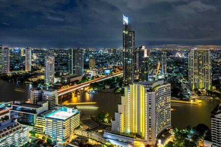 Bangkok city - Beautiful sunset curve Chao Phraya River long exposure light Cityscape urban  of Bangkok city at night  , panorama landscape Thailand