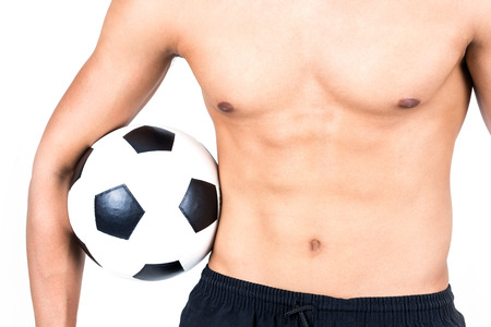 fitness man holding a soccer ball on white background