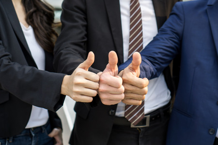 Team business partners giving Thumb up Successful teamwork partnership , business concept