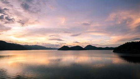 beautiful sunset on the reservoir at Khuean Srinagarindra National Park kanchanaburi povince , landscape Thailand Stock Photo