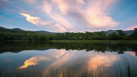 beautiful sunset on the reservoir , reflection of cloud , landscape thailand Stock Photo