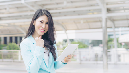 lifestyle business woman feel happy using smartphone ,  business concept Stock Photo