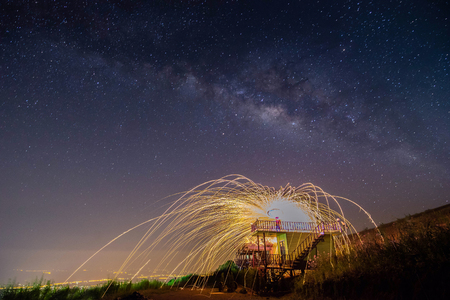 night landscape mountain and Wield the fire , milkyway galaxy background , long exposure ,low light 스톡 콘텐츠