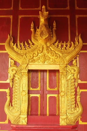 Golden Wood Carving,Traditional Thai Style in Thai Temple.  Stock Photo