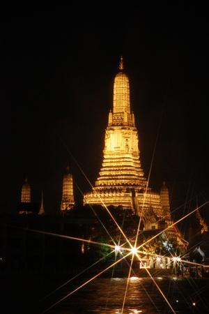 view of Wat Arun across Chao Phraya River in Bangkok, Thailand.