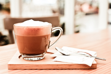 cappucino: cappucino coffee on wood table made vintage style. Stock Photo