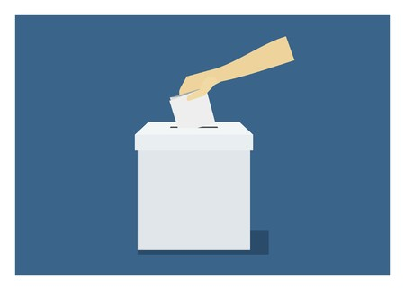 hand inserting ballot paper into a box