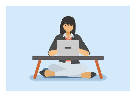 female student browsing using laptop on a small table