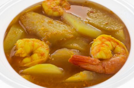 sumptuous: Southern thai traditional food. Thai sour curry is a sour and spicy. curry with shrimp,  sliced papaya, characteristic for its sour taste, which comes from tamarind and yellow comes from turmeric.