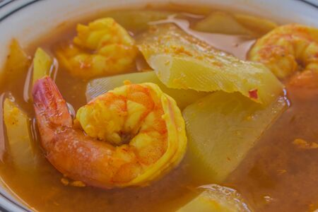 characteristic: Southern thai traditional food. Thai sour curry is a sour and spicy. curry with shrimp,  sliced papaya, characteristic for its sour taste, which comes from tamarind and yellow comes from turmeric.