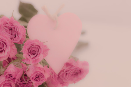 Pink roses with heart card soft background.