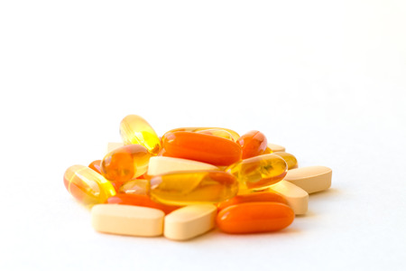Vitamins and Healthy Supplements on white background. Stock Photo