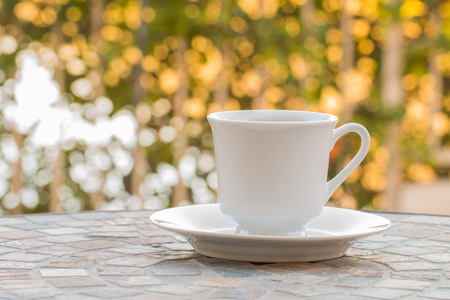 Coffee cup in the moring on  table  with bokeh background.