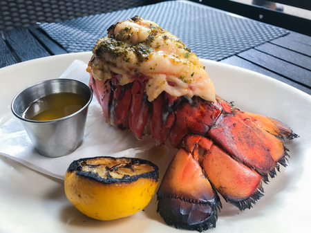 Grilled lobster tail served with lemon and butter Sauce.