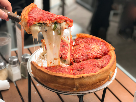 Cheese pizza, Chicago style deep dish italian cheese pizza with tomato sauce. Stock Photo