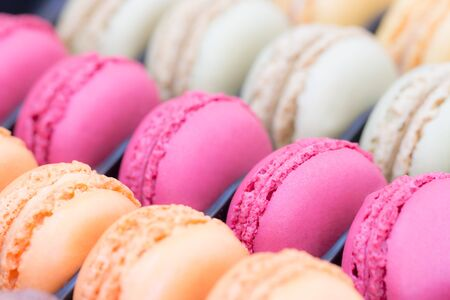 Colorful french macaroon cake in the box.