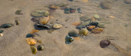 rocks water: gravel  in the lake Stock Photo