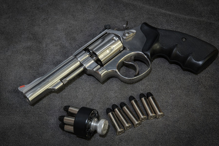 .38 Revolver with ammunition and Speedloader Stock Photo