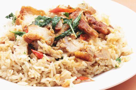 rice topped with stir fried crispy pork and holybasil photo