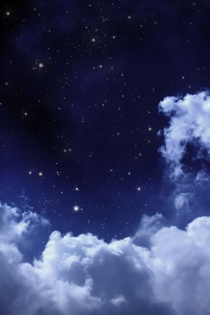 cloudy night sky with stars Stock Photo