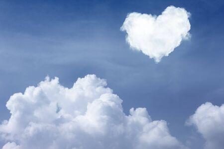 heart shape cloud on blue sky photo