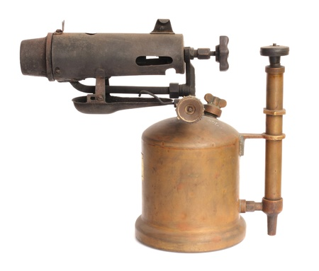blowtorch: antique blowtorch isolated on white background Stock Photo