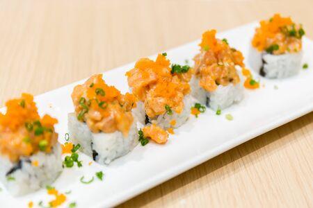 freshly cooked: Plate of freshly cooked salmon sushi.