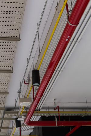 Pipe system hanging on ceiling. Reklamní fotografie