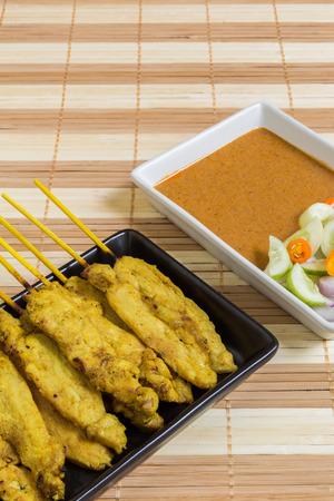 peanut sauce: Thai grilled curry pork with peanut sauce and salad.