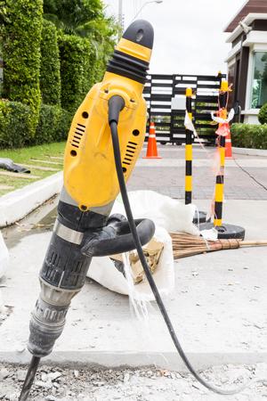 presslufthammer: Jackhammer on Road.  Jackhammer to Repair Road Lizenzfreie Bilder