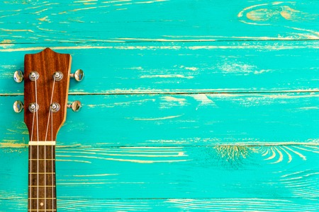 Ukulele on Blue Wooden Background