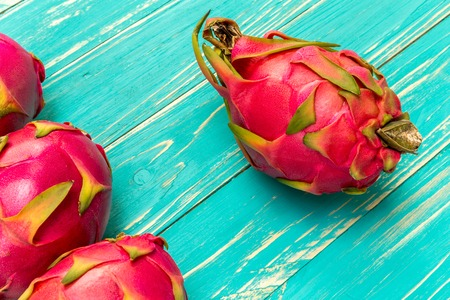 exotic fruits: Dragon Fruit, Tropical, Fruit from Asia on Blue Wooden Background