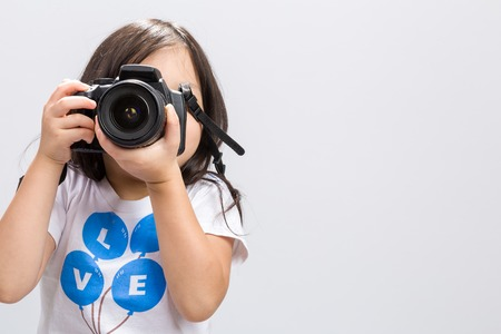 Child Holding Camera Background Foto de archivo