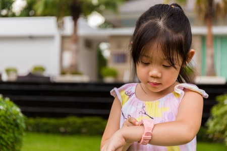 Child Using Smartwatch or Smart Watch. Child with Smartwatch or Smart Watch