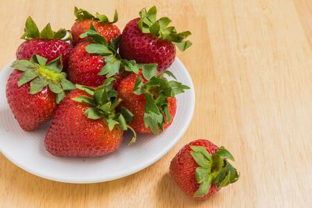 strawberry: Strawberry Background. Strawberry. Group of Strawberries Served on Wooden Background