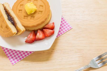 tea break: Waffle for Tea Break Background. Waffle for Coffee Break. Waffle for Tea Break Served on Wooden Background