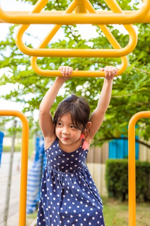 Happy Young Girl Playing on Playground Imagens