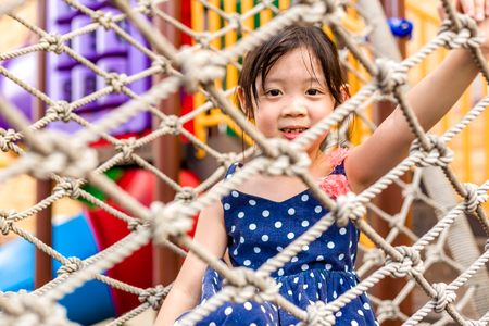 playground equipment: Happy Child Playing on Playground Stock Photo