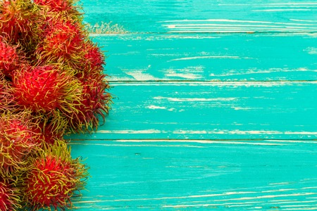Tropical Fruit on Wooden Background