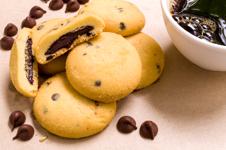 filled: Biscuit with Coffee on Wooden Background