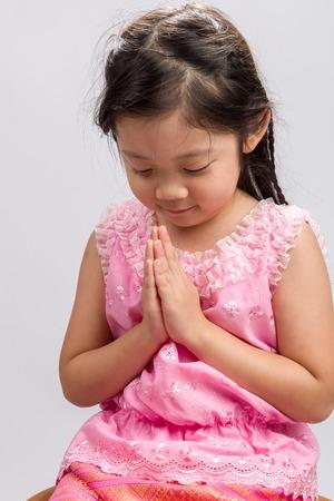 thai girl: Thai Kid Greeting Sawasdee Background Stock Photo