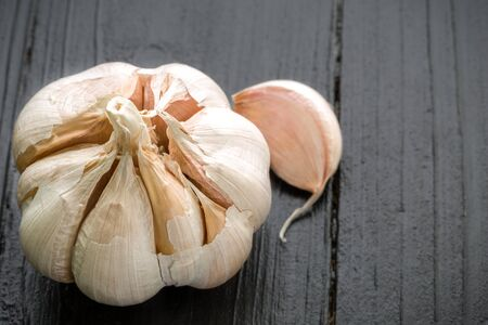 Garlic on Black Wooden Background